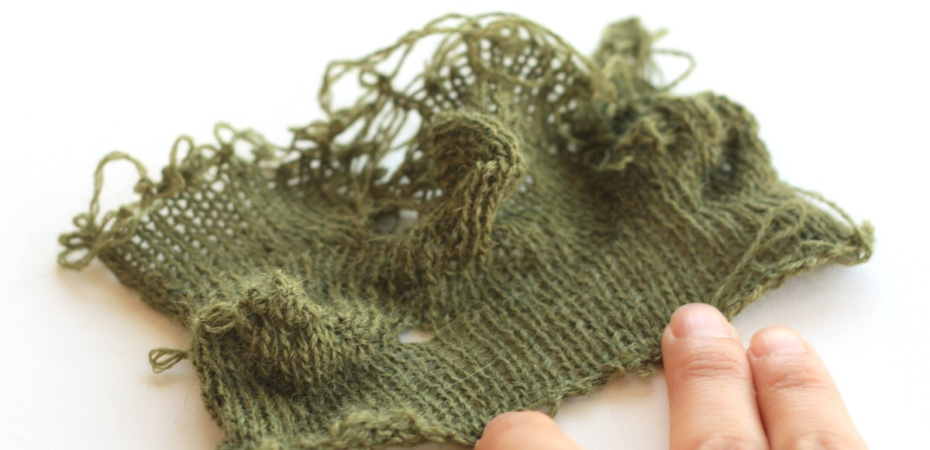 snarled, knotted, and torn yarn swatch